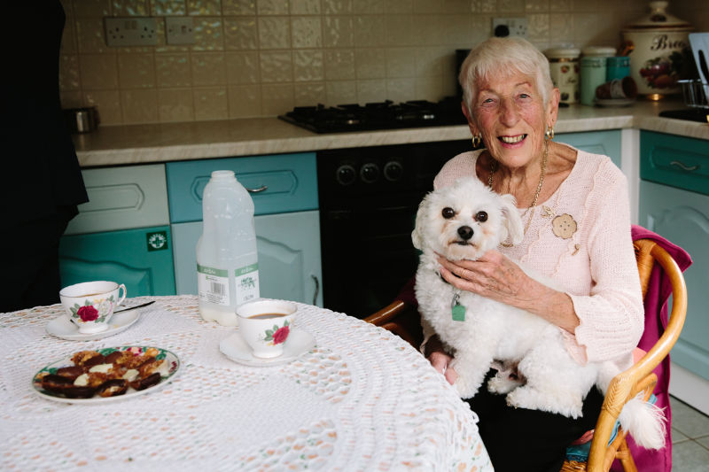 Elderly woman holding a dog