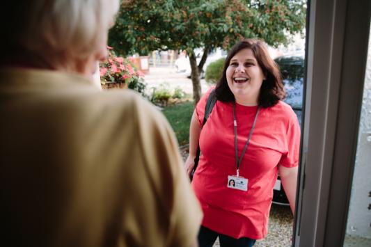 A Wellbeing support worker at somones door