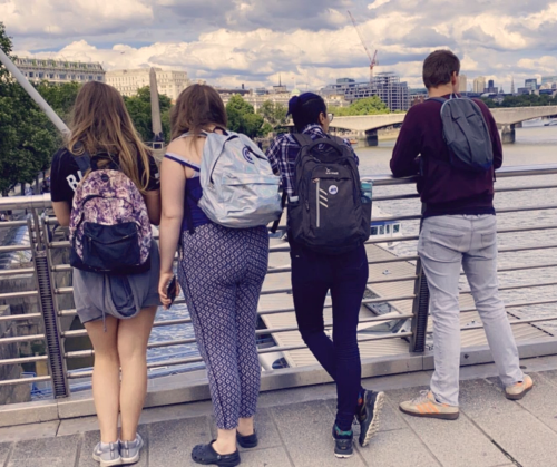 Young people admiring the view from a bridge